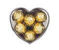 Gold chocolate in heart shape box isolated on white Royalty Free Stock Photo