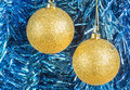 Gold christmas balls on the background of tinsel blue Stock Image