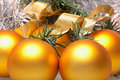 Gold christmas balls five christmass ball and silver tinsel Stock Photography