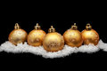 Gold christmas balls with snow Stock Image