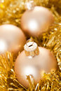 Gold Christmas baubles Royalty Free Stock Photos
