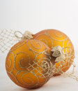 Gold christmas baubles isolated on white background Stock Photos