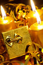 Gold christmas candles and gold gift boxes Stock Images