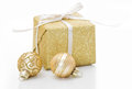 Gold Christmas gift box with bauble decorations isolated on whit Royalty Free Stock Photo