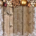 Gold Christmas ornament top border with snow frame on wood Royalty Free Stock Photo