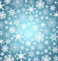 Gold christmas snowflakes background falling silver blue Royalty Free Stock Photos