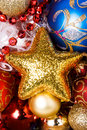Gold Christmas star with different splendid toys Stock Photo