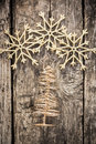 Gold christmas tree decorations on grunge wood background winter holidays concept Royalty Free Stock Photos