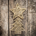Gold christmas tree decorations on grunge wood background winter holidays concept Stock Photos