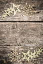 Gold Christmas tree decorations on grunge wood Royalty Free Stock Photo