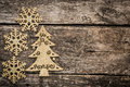 Gold christmas tree decorations on grunge wood background winter holidays concept copy space for your text Stock Photography