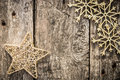 Gold christmas tree decorations on grunge wood background winter holidays concept copy space for your text Stock Image