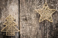 Gold christmas tree decorations on grunge wood background winter holidays concept copy space for your text Stock Images