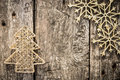 Gold christmas tree decorations on grunge wood background winter holidays concept copy space for your text Stock Photos