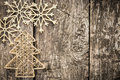 Gold christmas tree decorations on grunge wood background winter holidays concept copy space for your text Royalty Free Stock Image