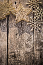 Gold christmas tree decorations on grunge wood background winter holidays concept copy space for your text shallow depth of fields Royalty Free Stock Images
