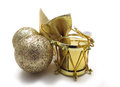 Gold christmas tree ornaments drum ribbon and sparkly balls Stock Photos