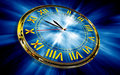 Gold clock on abstract blue background Royalty Free Stock Image
