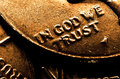 Gold coins representing wealth riches with in god we trust inscription and Royalty Free Stock Photos