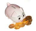 Gold coins surrounding pink piggy bank Royalty Free Stock Photos