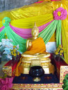Gold-colored Buddha statue in Buddhist temple Royalty Free Stock Photo