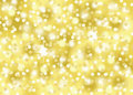 Gold confetti glitter holiday festive celebration abstract bokeh background Royalty Free Stock Photo