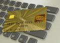 Gold credit card on a laptop pc keyboard Stock Photography