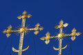 Gold crosses on blue skies Royalty Free Stock Images