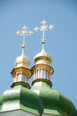 Gold crosses on the green domes Stock Photo