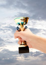 Gold cup winner against the blue sky Royalty Free Stock Image