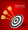 Gold darts hitting a target. Success concept. Royalty Free Stock Images