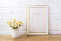 Gold decorated frame mockup with chamomile bouquet in rustic vas