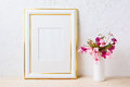 Gold decorated frame mockup with pink and purple flower bouquet Royalty Free Stock Photo