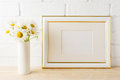 Gold decorated landscape frame mockup with daisy flower in vase Royalty Free Stock Photo