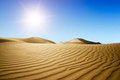 Gold desert into the sunset. Royalty Free Stock Photos