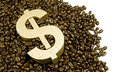 Gold dollar in coffee beans Royalty Free Stock Photo