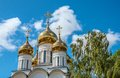 Gold domes white orthodox church with Stock Photo