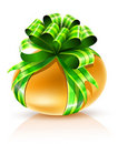 Gold easter egg with green ribbon isolated Stock Images