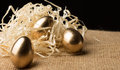 Gold Easter eggs on a black background