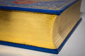 Gold edge of closed old vintage book with blue cover Royalty Free Stock Photo