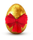 Gold egg with red bow on white background Royalty Free Stock Images
