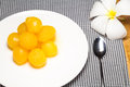 Gold egg yolks drops dessert Stock Images