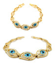 Gold evil eye bracelet display of two perspectives of a isolated on white Royalty Free Stock Photography