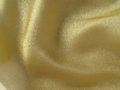 Gold fabric embroidered background Royalty Free Stock Photography