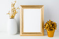 Gold fame mockup with white vase and golden flowerpot Royalty Free Stock Photo