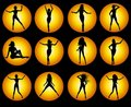 Gold Female Silhouette Icons on Black Royalty Free Stock Photos