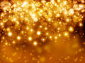 Gold festive background fantasy bokeh with stars Royalty Free Stock Photos