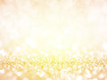 Gold festive christmas background abstract twinkled bright with bokeh defocused golden lights Stock Photography