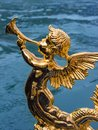 Gold figure of an angel on a gondola Royalty Free Stock Photo