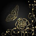 Gold floral pattern and butterfly on black background Royalty Free Stock Photo
